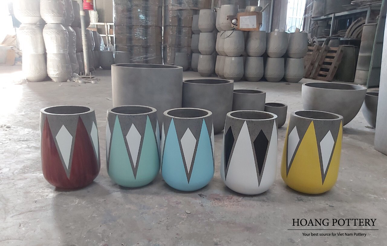 GEOMETRIC PATTERN PAINTED CEMENT PLANTERS CREATE ATTRACTIVE AND MODERN VIEWS IN INDOOR AND OUTDOOR DECORATION